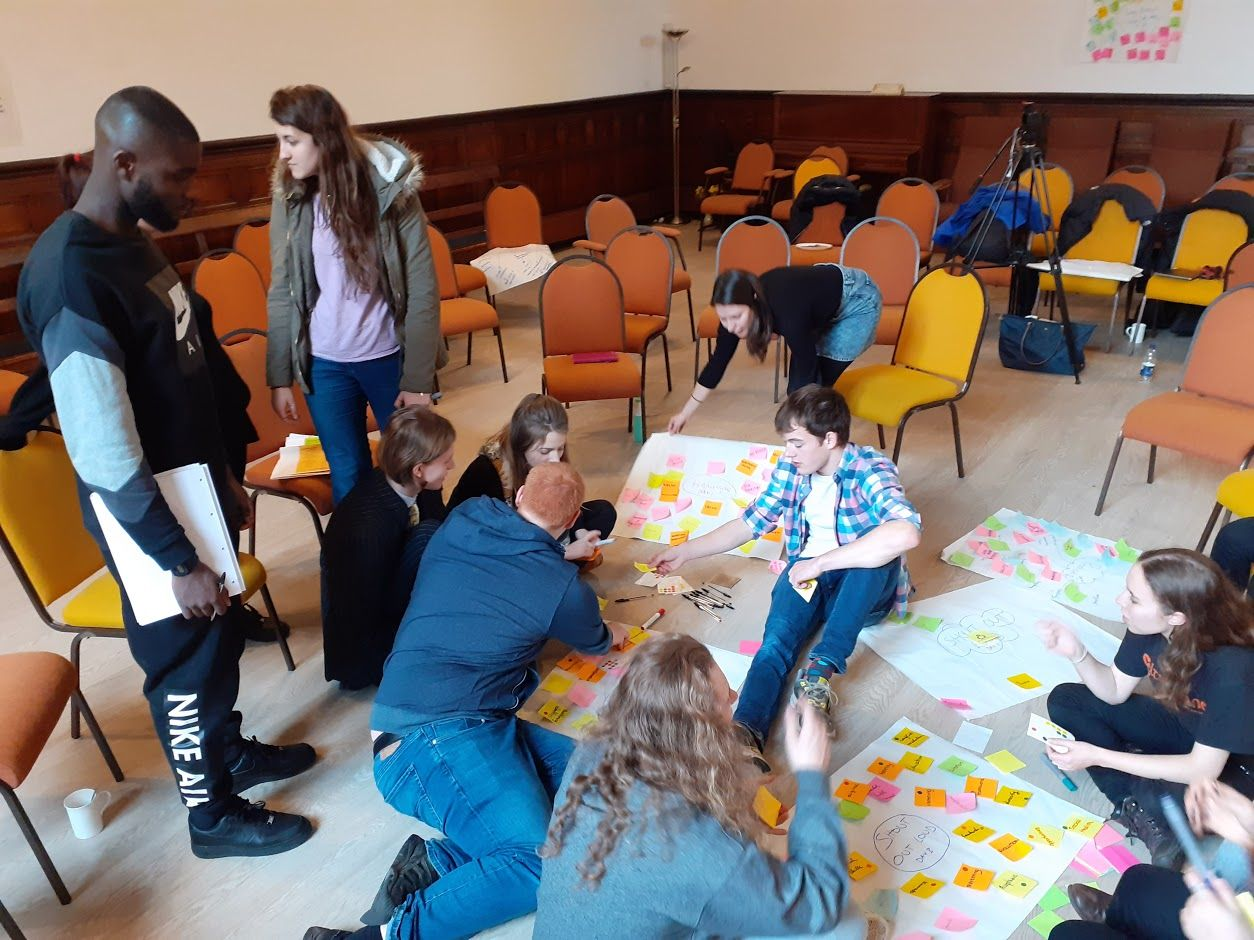 group of young people coming up with ideas