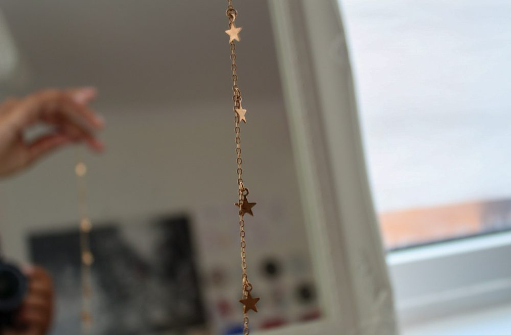 star necklace being held