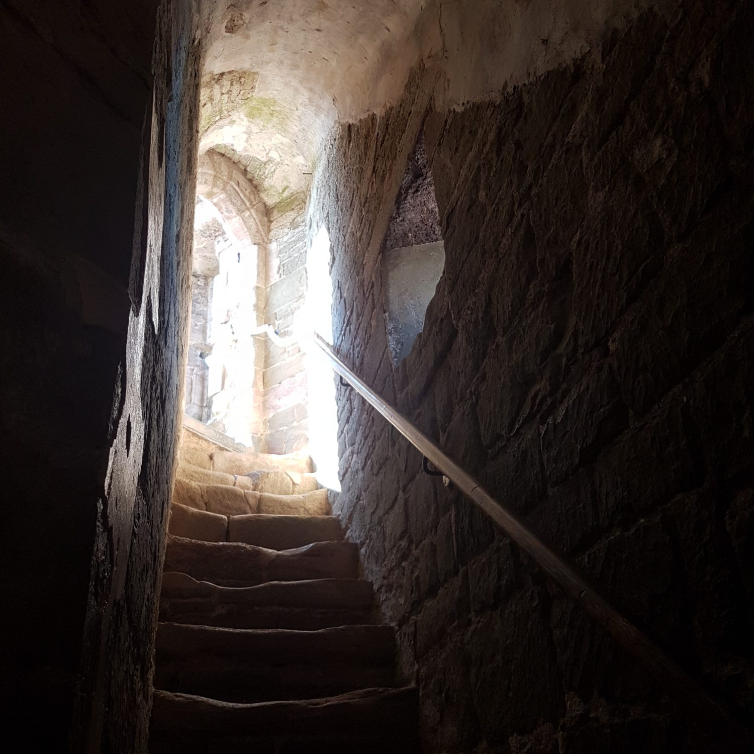 stair way leading to daylight