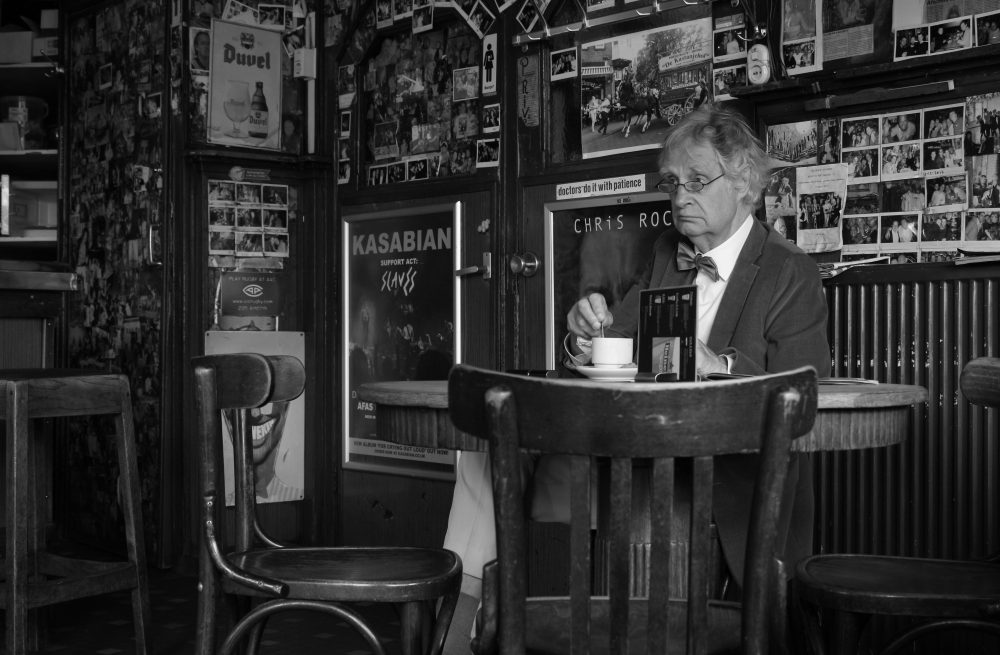 Man sat in a cafe alone