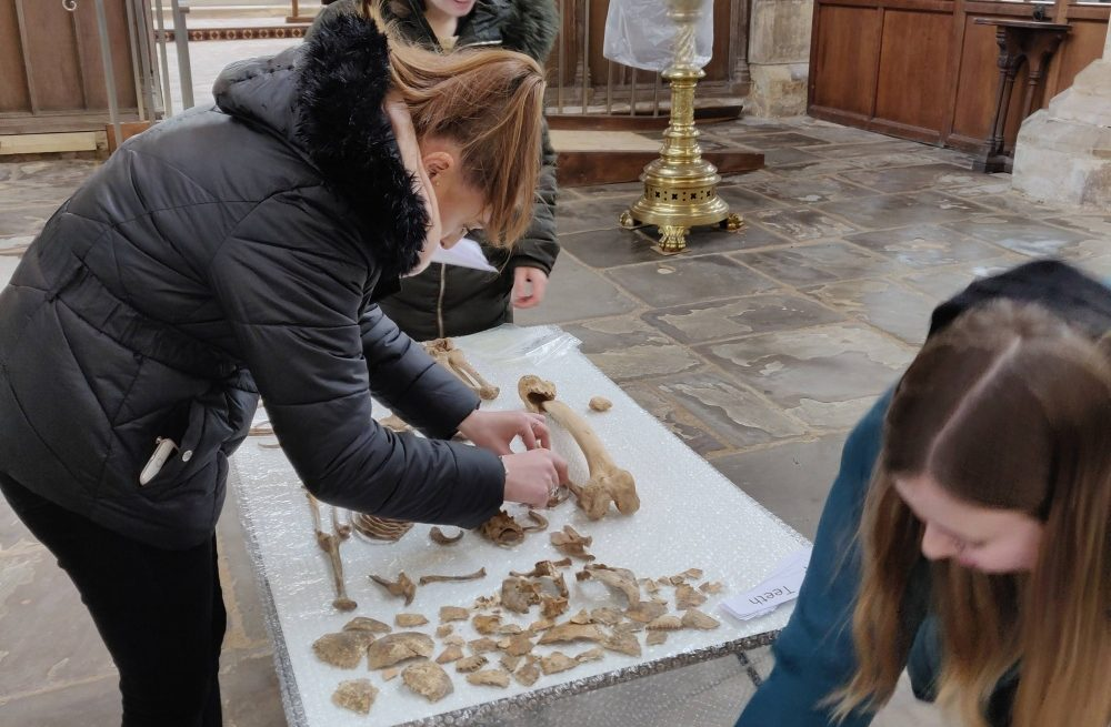 Girls examining remains