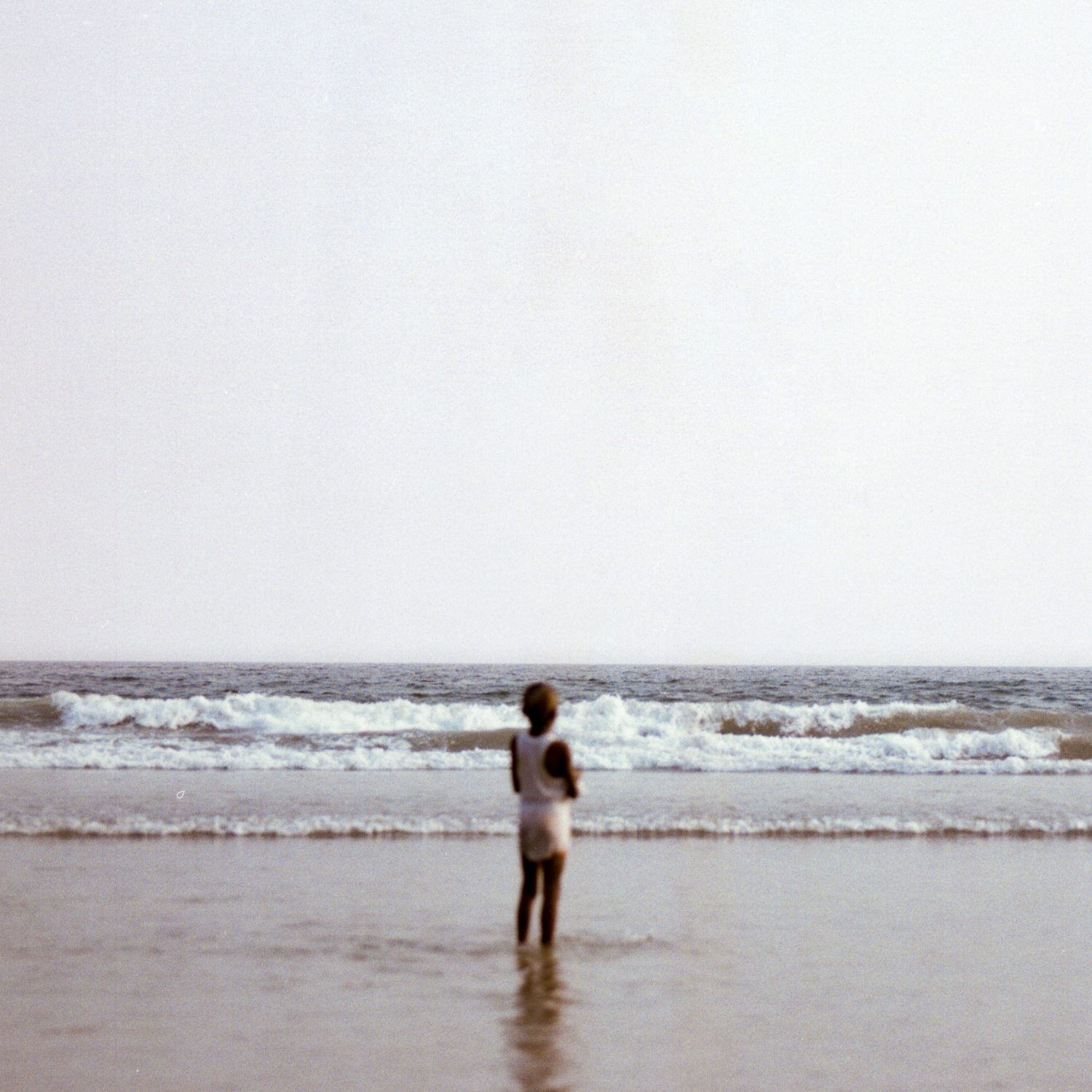 Photo of small boy looking out to sea
