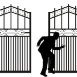 Silhouette of a person sneaking past gates