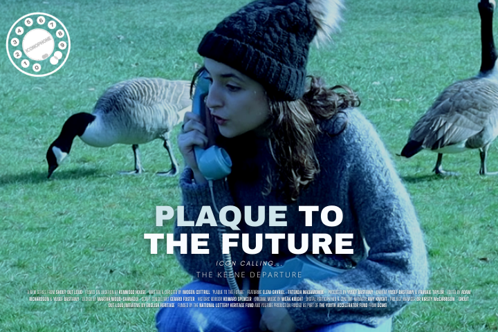 Ada crouched beside some geese on the blue old fashioned phone